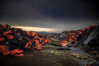 """Dusk sets in over the 'Life Jacket Graveyard' on Lesvos. It felt like an otherworldly place, so full of stories - of survival, of life and of death. It seemed to evoke the imagery and light of Golgotha. It was one of many moments where the refugee crisis felt biblical in scale."""